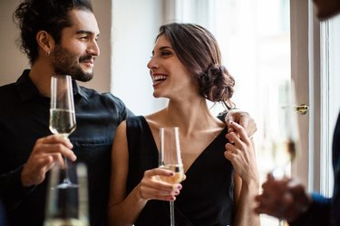 Couple holding champagne flutes