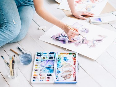 art therapy woman sitting painting watercolor