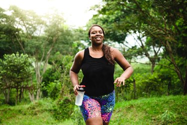 Body positive woman exercising in nature
