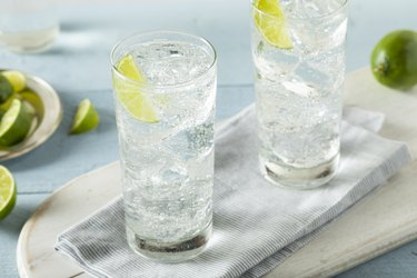 Two glasses of sparkling water with lime slices