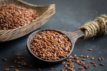 magnesium-rich flax seeds on wooden spoon