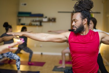 Man practicing yoga for a cross-training workout