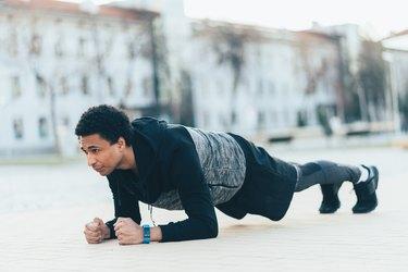 Sporty man doing plank