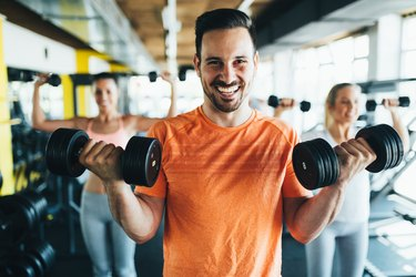 Man doing an upper body superset workout