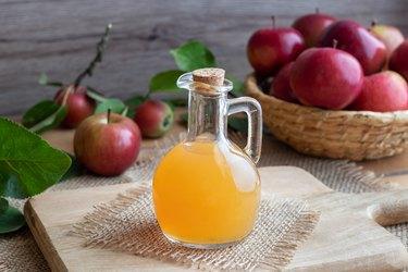 A bottle of raw unfiltered apple cider vinegar.
