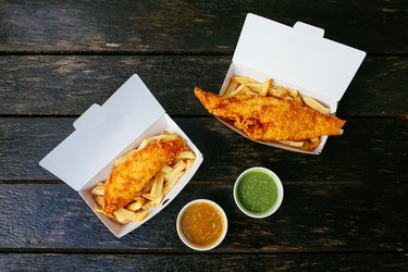 Fish and chips on a wooden table