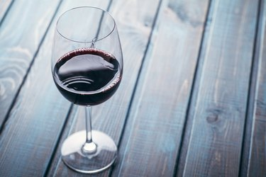 Red wine on blue wood
