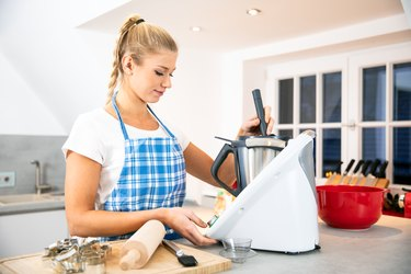 Woman using meal prep tools for baking in the kitchen