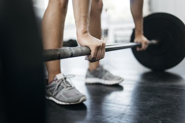 Woman lifting weights with wrist pain