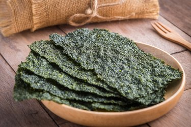 Crispy dried iodine-rich seaweed on wooden plate