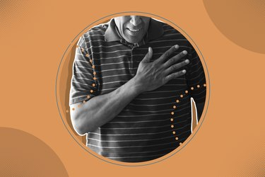 A man clutching his chest, one of the classic signs of a heart attack, with orange background