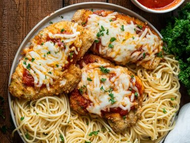 Air Fryer Chicken Parmesan on plate with spaghetti