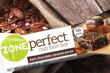 zone perfect chocolate pecan bar on pecans and wood