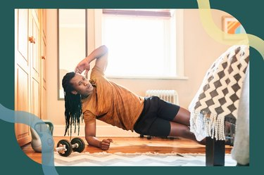 Man doing a side plank in his bedroom during the plank challenge
