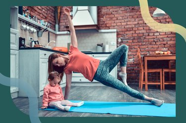 Woman doing a Tree pose side plank with her daughter on her yoga mat during the plank challenge