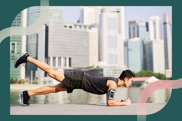 Man doing a forearm plank with leg lift in front of a downtown cityscape for the plank challenge