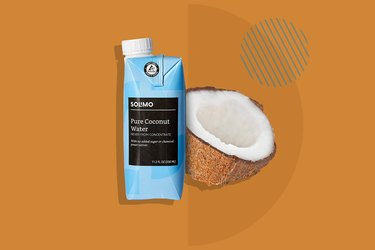 A photo of Solimo Coconut Water and a halved coconut