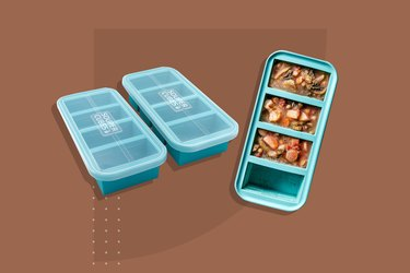 Three souper cubes on a brown background; one contains three servings of a vegetable soup, the other two are empty and contain lids.