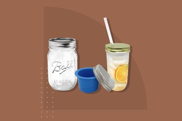 A standard Mason jar positioned near its updated accessories, including a cup separator and a top thats fitted for a traw.
