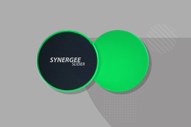 green and black Synergee core exercise sliders on gray background