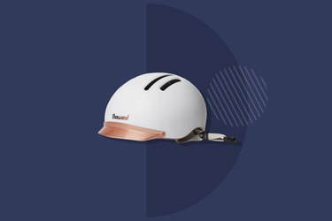 white Thousand Chapter MIPS bike helmet on navy background