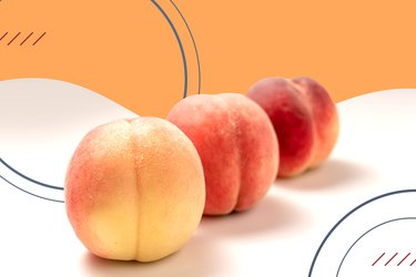 Three peaches on an orange and white background
