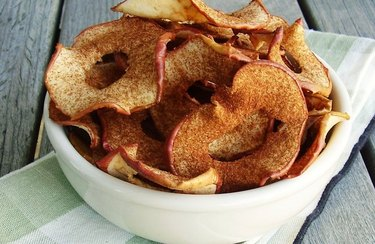 A bowl of apple chips with cinnamon