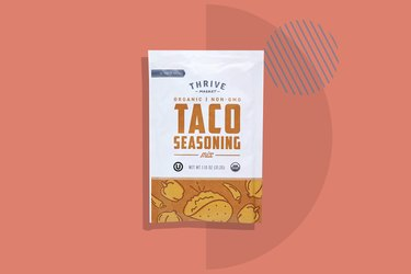 Thrive Market's Organic Taco Seasoning depicted on a salmon background