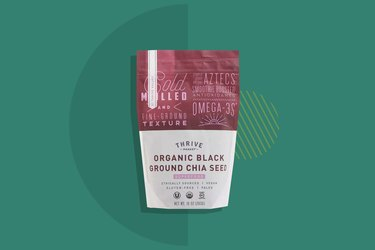 Thrive Market Organic Black Ground Chia Seed displayed on a forest green background