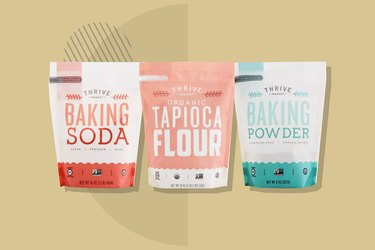 Gluten-free baking soda, tapioca flour and baking powder displayed on a beige background