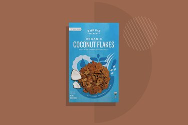 A box of Thrive Market Organic Coconut Flakes Cereal displayed on a brown background