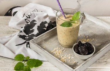 Digestive Smoothie with mint leaf on wooden board