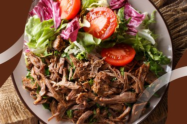 Healthy Instant Pot Carnitas with lettuce and tomato on a white plate on wooden table