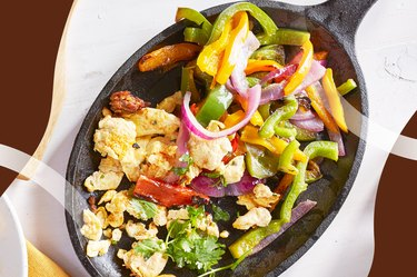 Fajita skillet with vegetables on a white counter