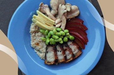 Roast Pork Belly Oatmeal with edamame and mushrooms in a blue bowl