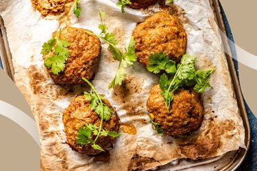 Breakfast Turkey-Apple Sausage Mini Patties on parchment paper and topped with parsley