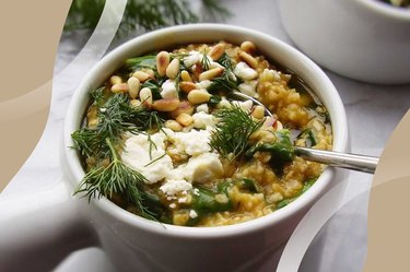 Greek Spinach and Feta Oatmeal in a white bowl with a spoon