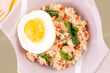 Kale, Turkey Sausage and Egg Oatmeal in a light pink bowl