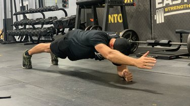 1. Plank With Alternating Arm Lift