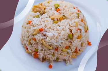 Turkey Fried Rice with peas and carrots on a white plate