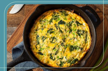 Healthy breakfast frittata with leafy greens in a cast iron skillet on a countertop