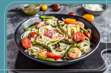 A healthy pasta dish for dinner with sautéed vegetables and shrimp