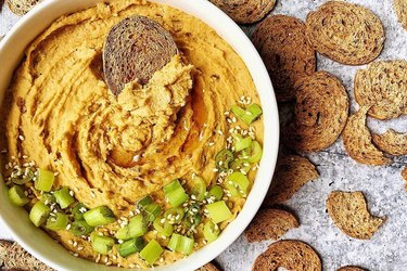 Mediterranean snacks of healthy crackers with hummus