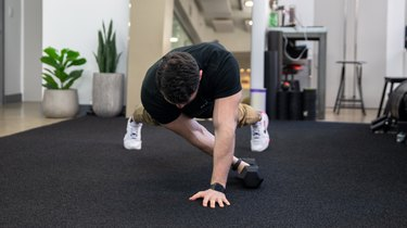 Move 1: High Plank Dumbbell Pull-Through