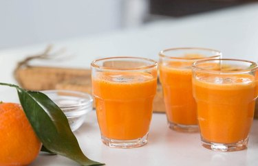 Anti-inflammatory Drink Ginger Turmeric Immunity Shot in glasses with an orange