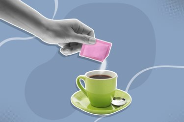 hand pouring content in pink sugar packet into coffee