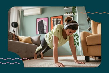 woman in high plank position about to do push-up for 30-day push-up challenge at home