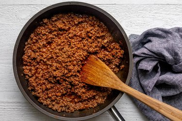 Season beef with spices; cook until sauce thickens.