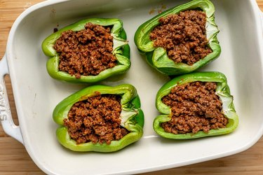 Fill pepper halves with beef.