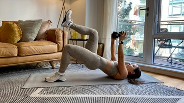 Move 1: Marching Glute Bridge With Dumbbell Hold